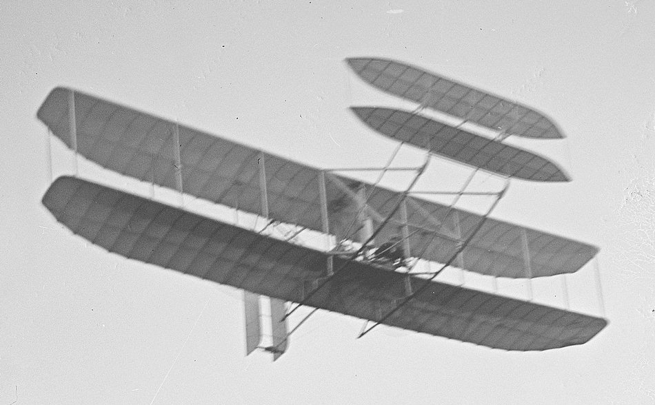 1905_Flyer_Orville_at_controls.jpg